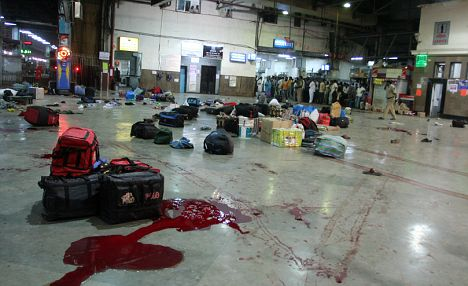 Massacre: Blood splatters the floor at the train station where travellers were slaughtered. Others abandoned their luggage and ran for their lives